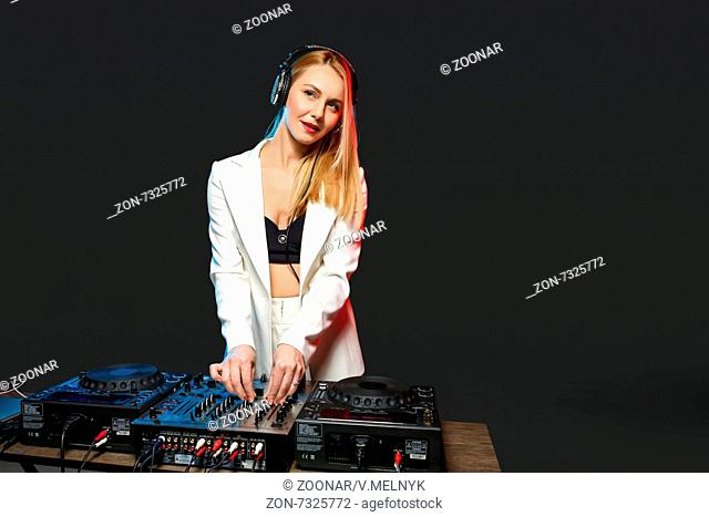 Beautiful blonde DJ girl on decks - the party