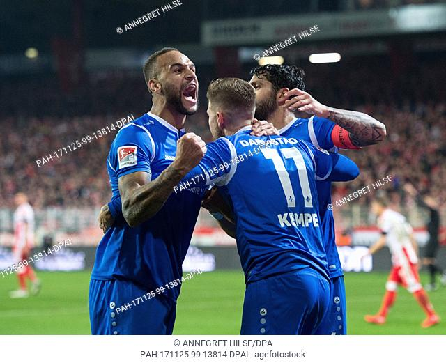 Darmstadt's Terrence Boyd, scorer Tobias Kempe and Aytac Sulu (l-r) celebrate the 2:3 penalty goal during the German 2nd division Bundesliga soccer match...