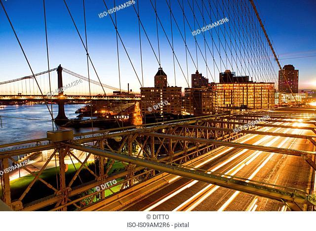 Traffic on Brooklyn Bridge at night, Manhattan, New York, USA