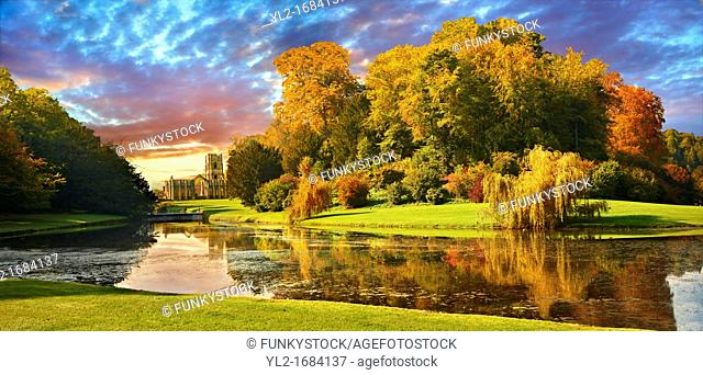 Auntumn view of Fountains Abbey & Studley Royal water gardens, founded in 1132, is one of the largest and best preserved ruined Cistercian monasteries in...