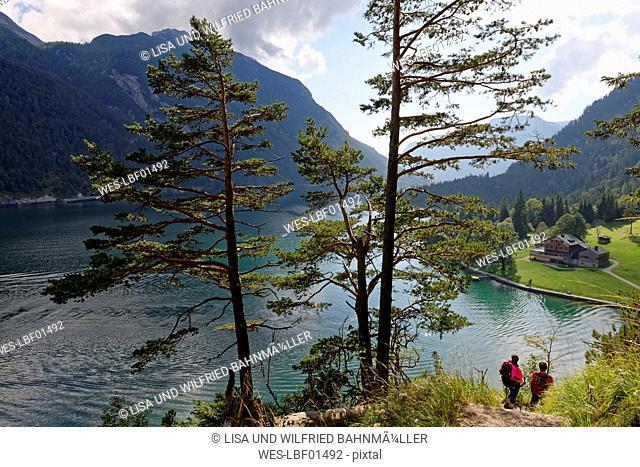 Austria, Tyrol, Hikers at Lake Achensee near Gaisalm