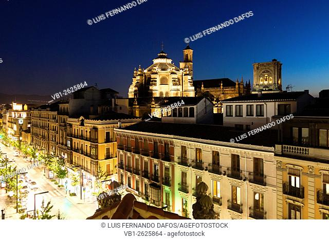 Floodlit cathedral and Gran Via st. at night. Granada, Spain