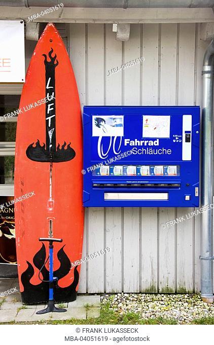 Vending machine, bicycle tubes, air pump, surfboard
