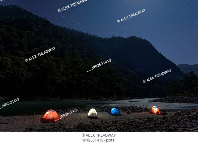 Camped along the banks of the Karnali River during a rafting trip, Nepal, Himalayas, Asia