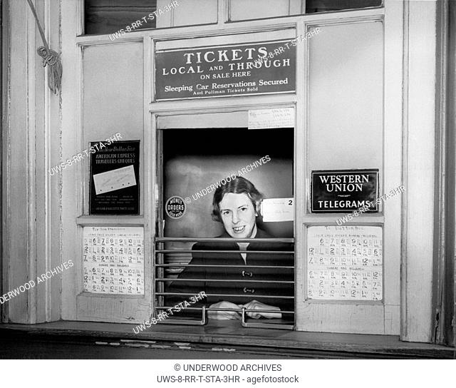 Oakland, California: c. 1946.A woman at at a railroad ticket counter selling tickets to San Francisco and Dutton Avenue in San Leandro