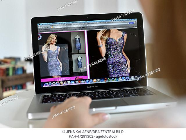 ILLUSTRATION - A young woman browses on her notebook computer through the web page of Chinese online retailer Alibaba looking at evening dresses on sale in...