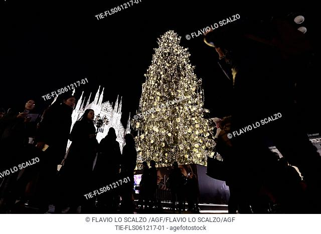 People attend the Christmas tree lighting ceremony at Duomo's square in Milan -ITALY-06-12-2017
