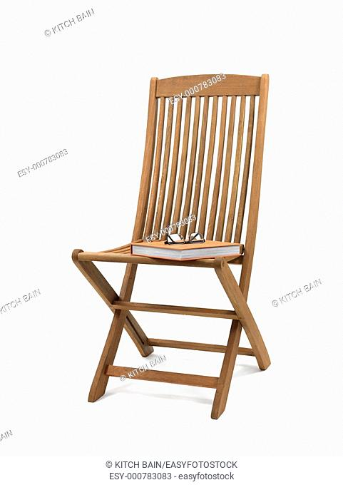 A deck chair isolated against a white background