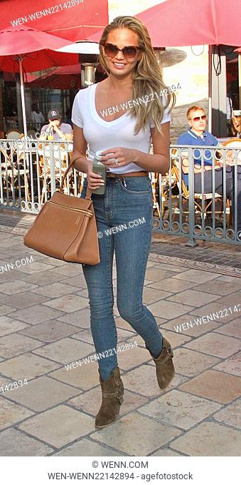 Model Chrissy Teigen out shopping at The Grove wearing a tight white top and jeans Featuring: Chrissy Teigen Where: Los Angeles, California
