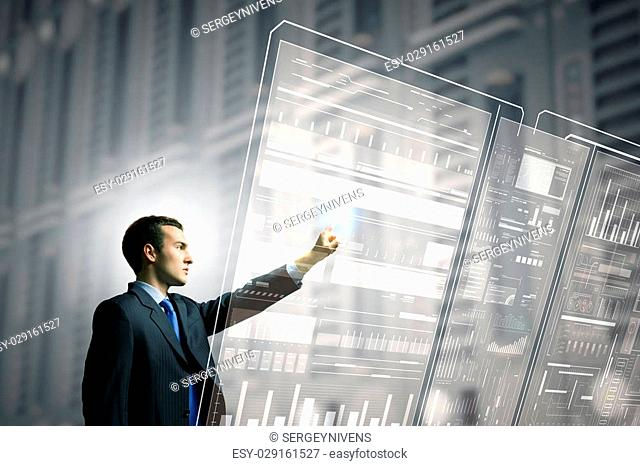Businessman pushing with finger icon on virtual screen