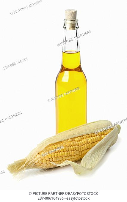 Maize oil and sweet corn on white background