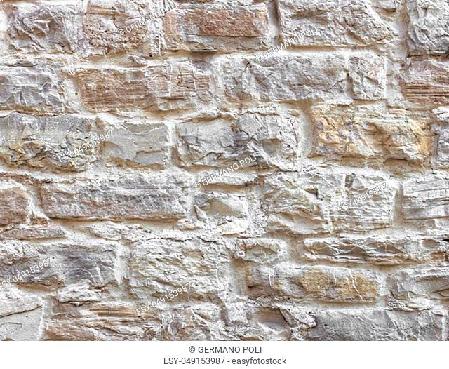 Texture of wall. Old wall made from bumpy stones
