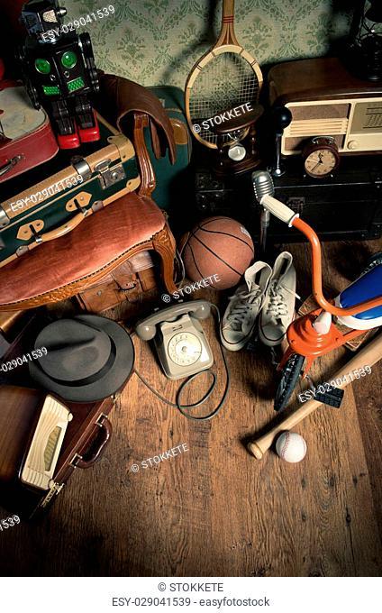 Group of assorted vintage items on hardwood floor at flea market