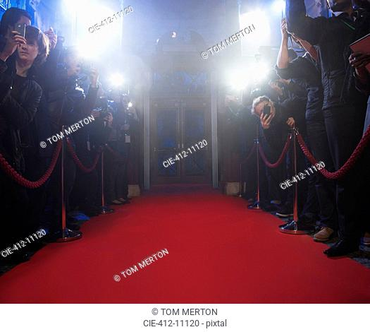 Paparazzi using flash photography along red carpet
