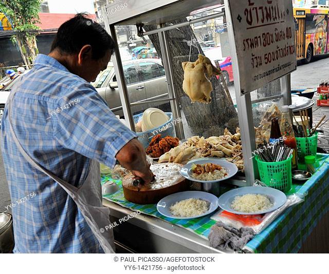 street chef preparing chicken and rice thai style, street cuisine, chinatown, bangkok, thailand