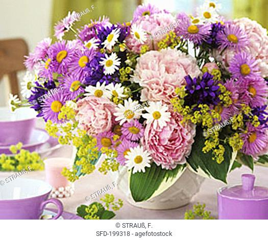 Peonies, asters, marguerites, Campanulas and lady's mantle