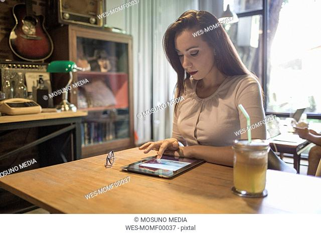 Woman using a tablet in a cafe