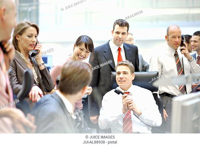 Businesspeople working at stock market