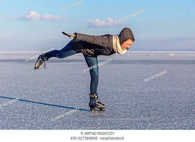 Young girl skating on Lake Balaton in Hungary