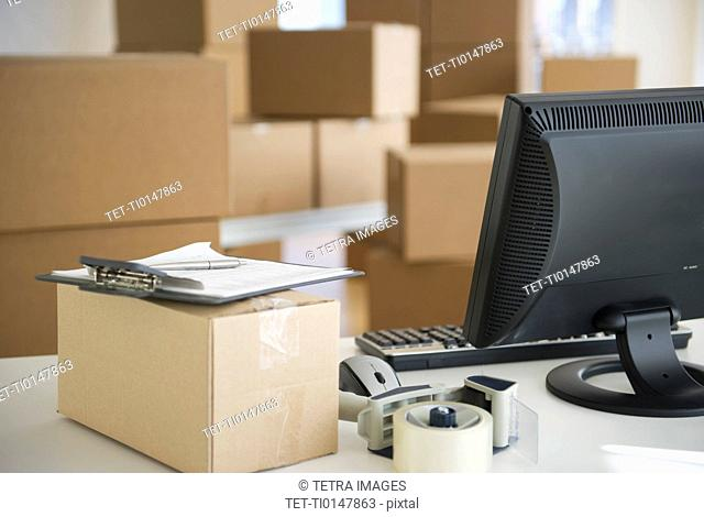 USA, New Jersey, Jersey City, boxes and computer at delivery warehouse