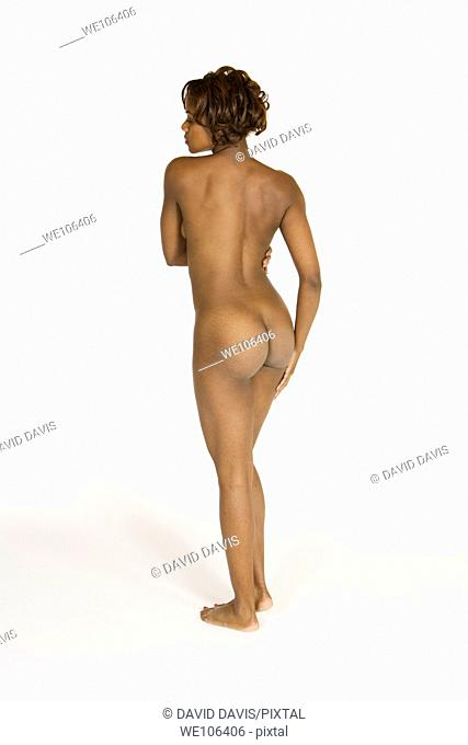 Very sexy and beautiful African American woman posing nude on a white background