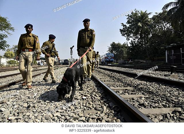 Security check. Guwahati, Assam, India. Jan. 21, 2019. Railway Protection Force (RPF) personnel inspect the railway tracks with a sniffer dog ahead of the...