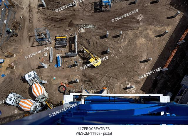 Concrete mixers on construction site, view from above
