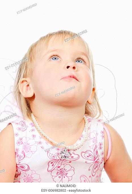 Portrait of cute little girl wearing wings looking up