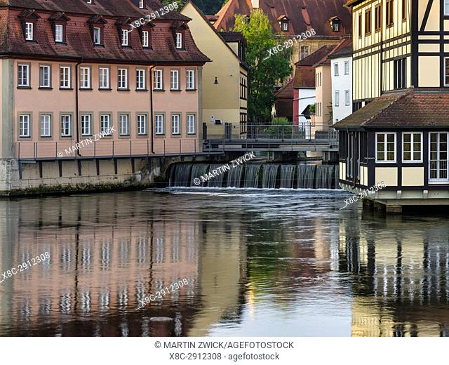 "The Old Town and river Regnitz. Bamberg in Franconia, a part of Bavaria. The Old Town is listed as UNESCO World Heritage """"Altstadt von Bamberg"""""