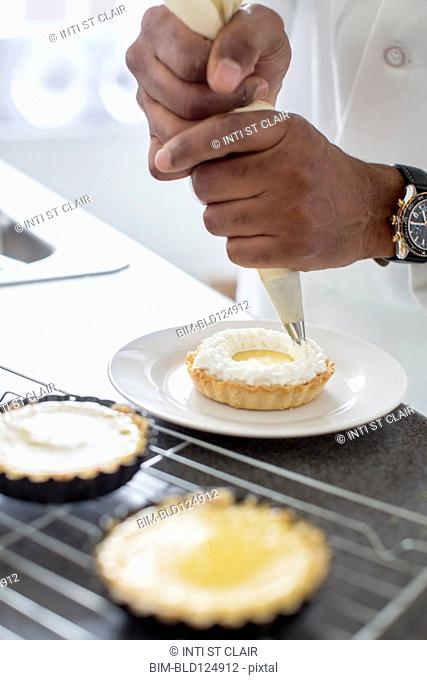 Black chef making key lime tart in restaurant
