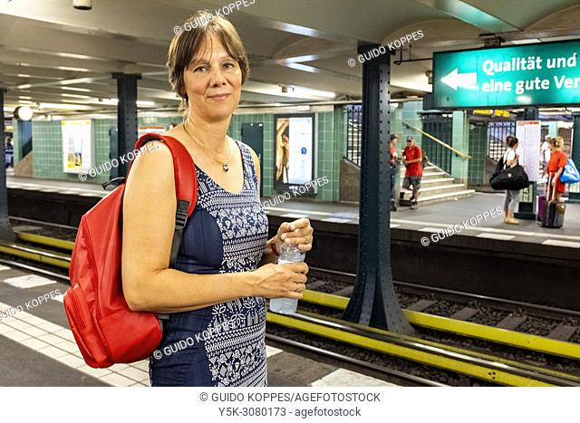 Berlin, Germany. Dutch, female expat, writer and foodblogger commuting by U-Bahn through the Nation's Capital, doing research for one of her assignors