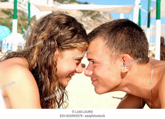 Young teenagres couple together in the beach