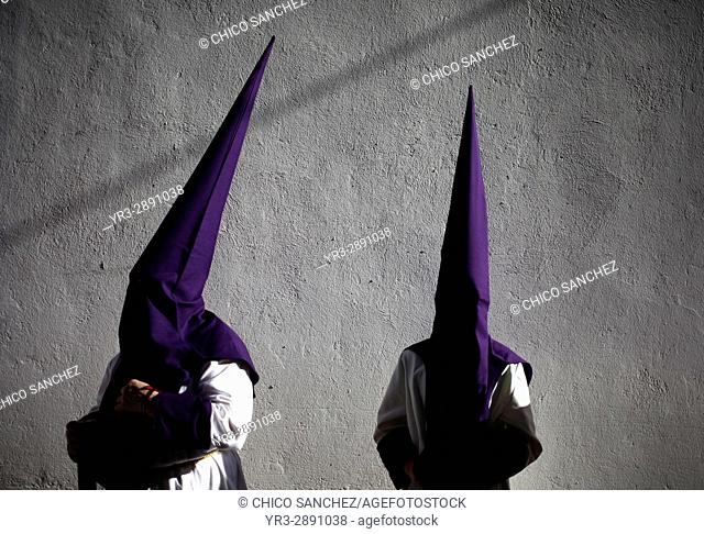 Penitents wearing pointed hoods during Easter Week celebrations in Baeza, Jaen Province, Andalusia, Spain