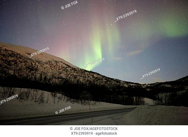 view of swirling northern lights aurora borealis near tromso in northern norway europe