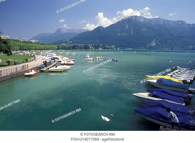 France, Annecy, Haute-Savoie, Rhone-Alpes, Europe, Lakeside park on scenic Lake Annecy (Lac d' Annecy) surrounded by mountains in Annecy