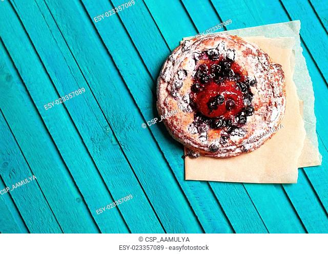 Homemade berry pie on a wooden background