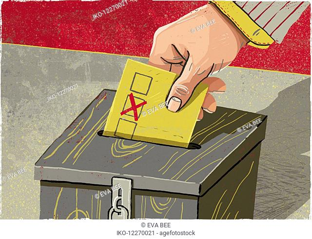 Hand depositing voting paper in ballot box
