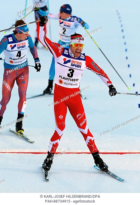 Alex Harvey from Canada celebrates after the men's 50 km mass start freestyle cross-country event at the Nordic Ski World Championship in Lahti, Finland