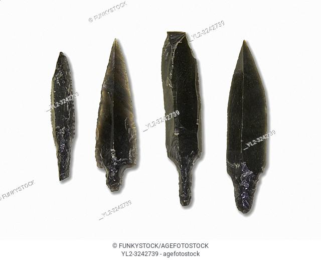 Black obsidian arrow heads. Catalhoyuk Collections. Museum of Anatolian Civilisations, Ankara. Against a white background