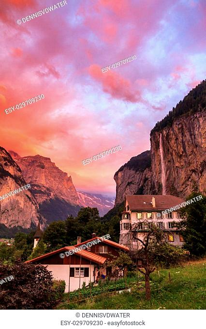 Amazing sunset in the Swiss village of Lauterbrunnen with the Staubbach Falls in the background