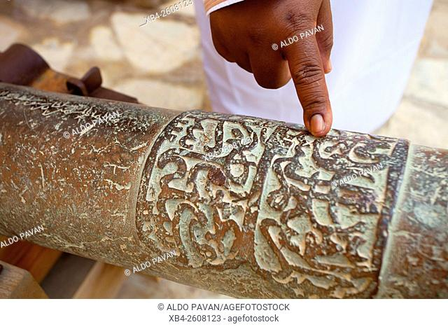 Oman, Nizwa, castle, particularly cannon inlaid