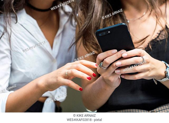 Woman's hands holding smartphone, close-up
