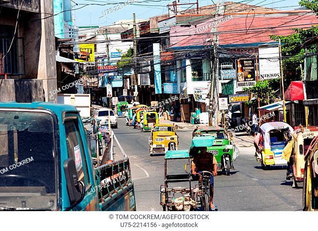 Street scene with tricycle taxis, CBD, Surigao, Mindanao, Philippines