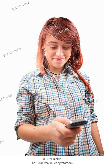 Teen woman reading or typing sms on mobile phone