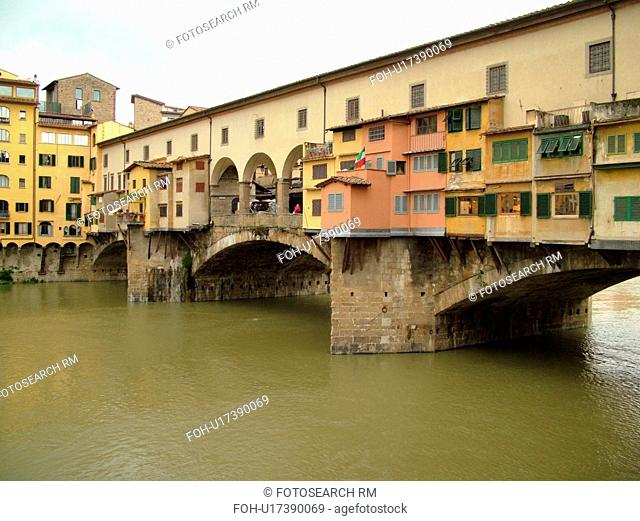 Florence, Italy, Firenza, Tuscany, Toscana, Europe, Ponte Vecchio, a bridge lined with shops, crosses the River Arno in the city of Florence