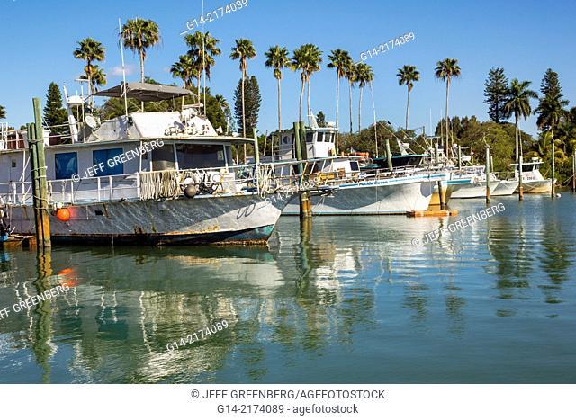 Florida, Port Charlotte Harbor, Placida, Gasparilla Sound, Gulf of Mexico, Seminole Trader, commercial fishing vessel, boat, rusted, dock,