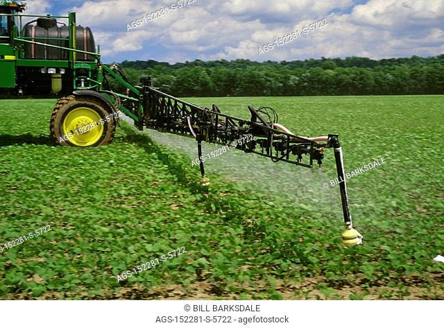 Agriculture - Chemical application, a John Deere high clearance sprayer applying Roundup Ultra Max to early growth Roundup Ready soybeans / TN