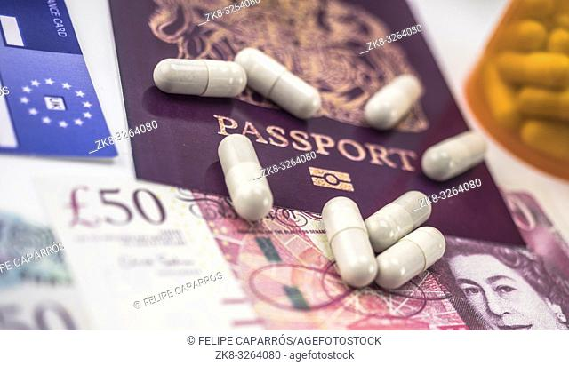 British passport and European health insurance card along with several capsules, concept of medical increase in the crisis of the brexit, conceptual image