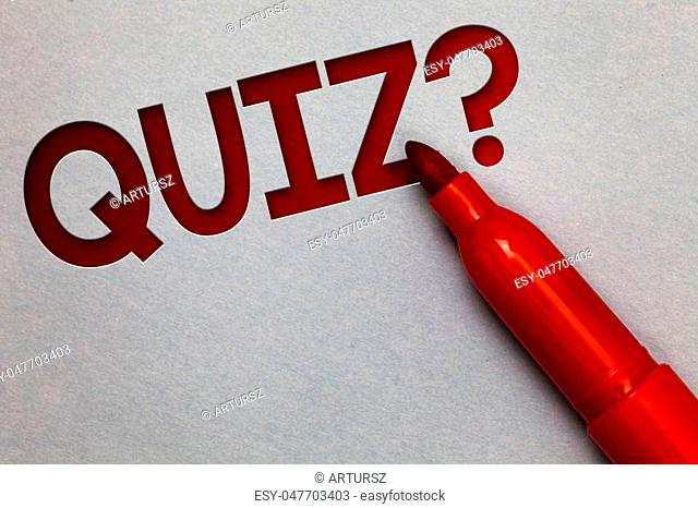 Text sign showing Quiz Question. Conceptual photo Short Tests Evaluation Examination to quantify your knowledge White paper lite grey shadow red marker pen nice...