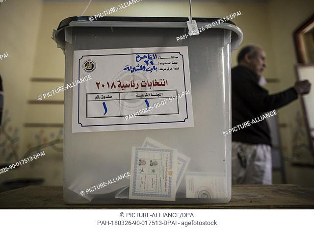 A ballot with the picture of Egyptian president Abdel Fattah al-Sisi and his opponent Moussa Mostafa Moussa inside a ballot box in a polling station on the...